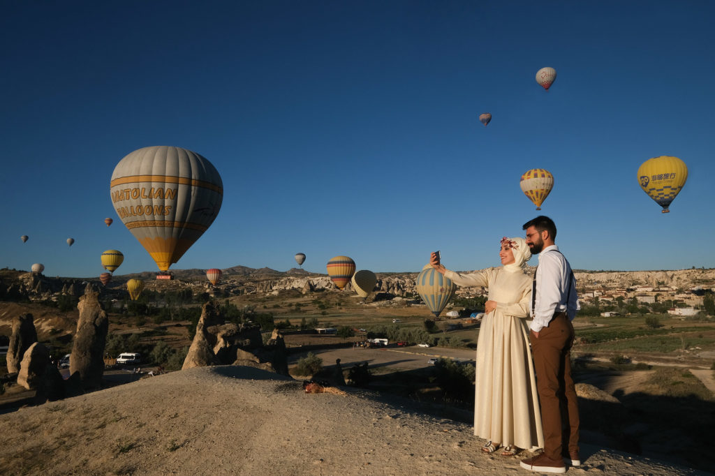 A beautiful couple doing selfie,Wedding in Cappadocia, Goreme with a young married couple
